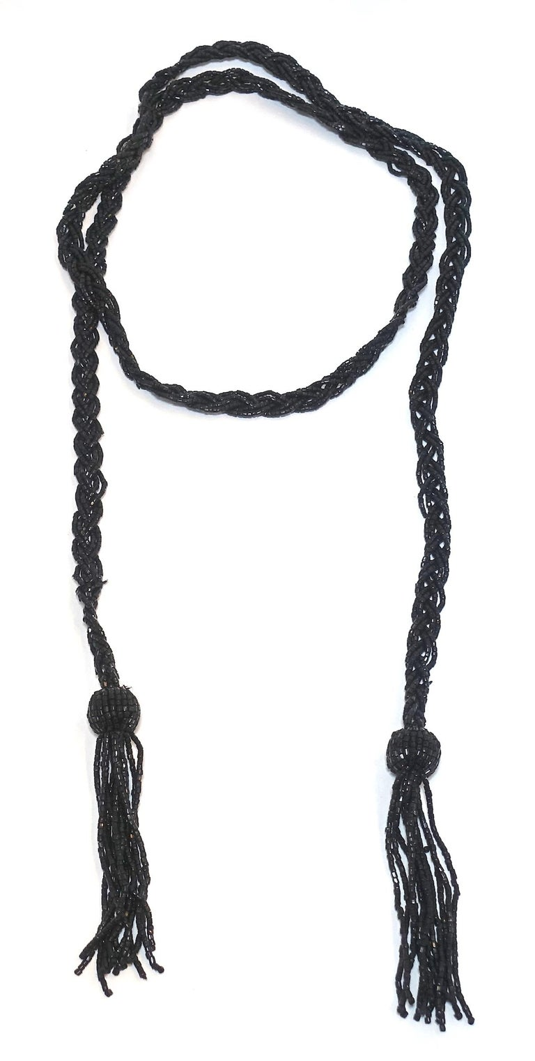 """This vintage art deco 1920ss necklace features a torsade design with black beading.  This piece measures 54"""" long x 1/2"""" and is in excellent condition."""