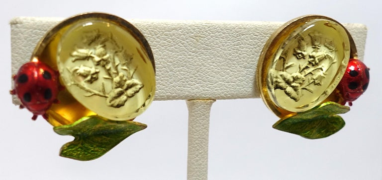 """These vintage signed Claudine Vilry Paris earrings feature a floral intaglio accented by an enameled bumble bee and leaf in a gold tone setting.  These clip earrings measure 1"""" x 1"""" and are signed """"Claudine Vilry Paris"""". They are in excellent"""