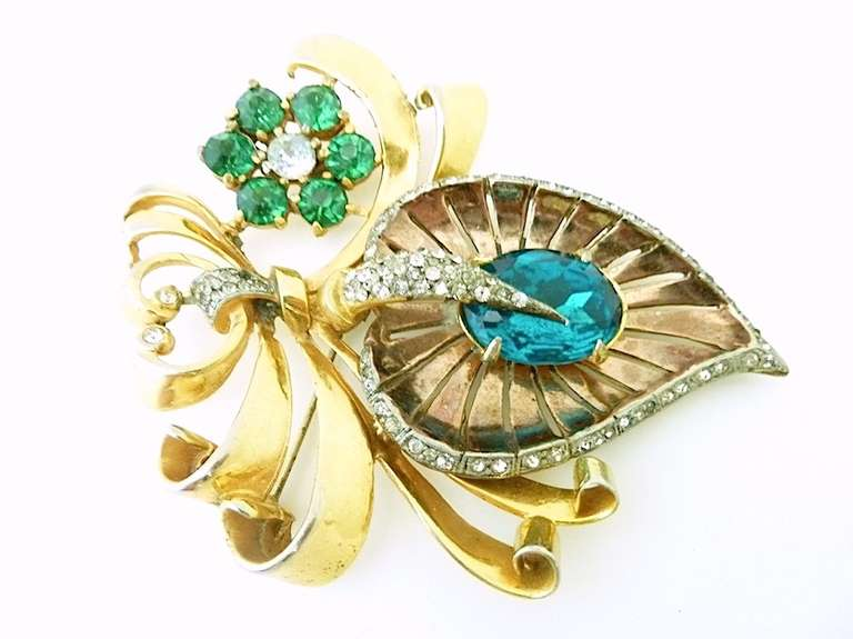 """This vintage unsigned Mazer pin features green and clear rhinestones in a gold-tone setting.  In excellent condition, this in measures 3 5/8"""" x 2 7/8""""."""