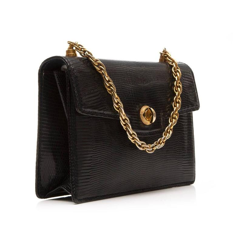 Gucci Vintage Handbag In Black Lizard Skin Featuring A Twist Lock Detail And Gold Tone