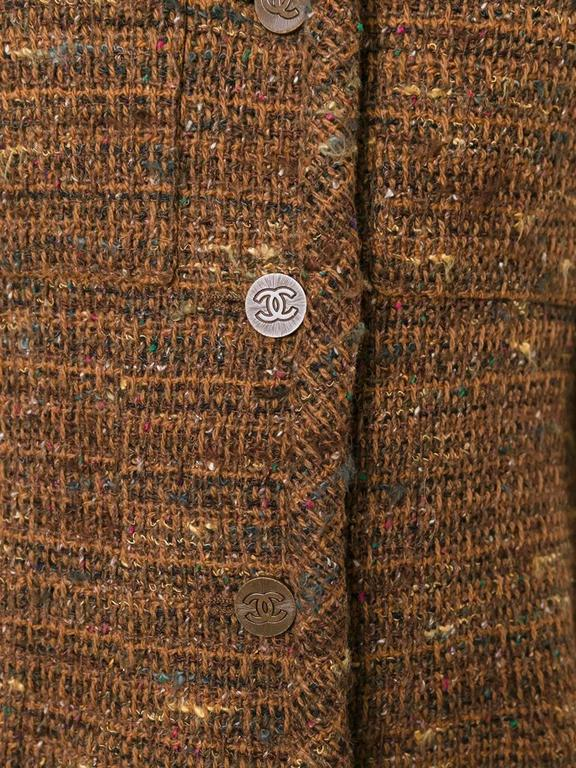 Brown wool blend bouclé blazer jacket featuring notched lapels, long sleeves, a front button fastening, a chest pocket and a full lining.   Colour: Brown  Material: Silk 100% / Wool 80% / Acrylic 20%  Measurements: Waist: 42cm, Bust: 48cms,