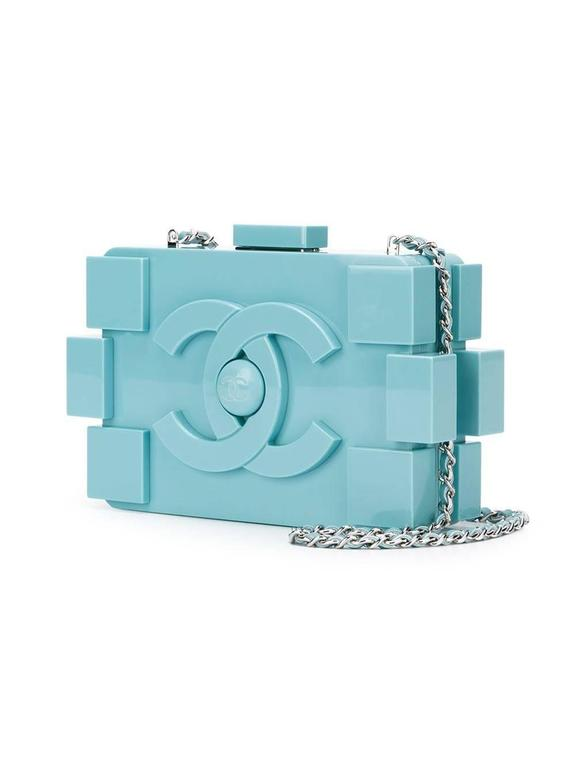 Baby blue plexiglass 'Boy Brick' clutch featuring a push lock fastening, a front centre logo stamp, a rectangular body, a silver-tone chain shoulder strap, an internal zipped pocket and an internal logo stamp. 