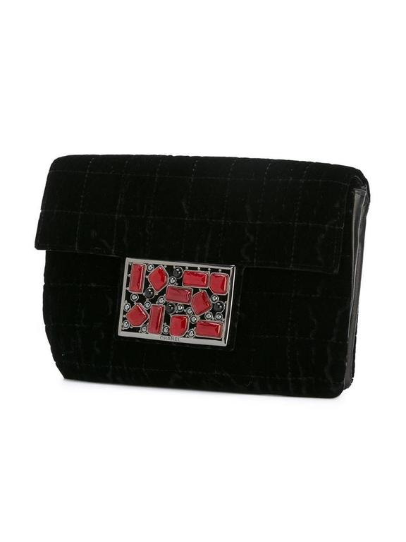Black velvet stone embellished clutch featuring a foldover top with magnetic closure, stitching details and an internal slip pocket. 