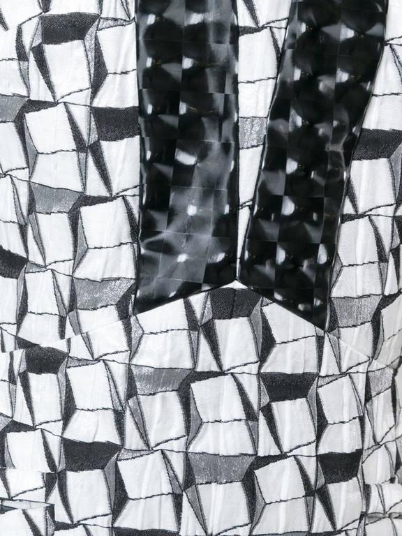 Black and white silk and cotton-silk blend geometric jacquard dress featuring a v-neck, a sleeveless design, a low back, an a-line shape skirt, a knee length and a straight hem.  Colour: Black / White  Material: Cotton 46% / Polyamide 42% / Silk