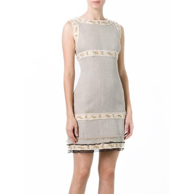 Discover the rustic romance of Chanel's spring/summer 2010 barnyard extravaganza with this vintage Chanel sleeveless dress. Cut from hessian, this dress is amped up in true Chanel form with gold-gilded trims, black lace hems and frayed edges.