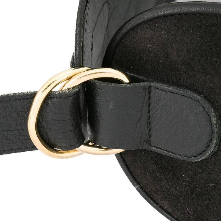 Sharply cut to a wide silhouette that accentuates the waist, this vintage Yves Saint Laurent belt is crafted from black suede whimsically studded with gold-tone baubles. The belt is lined and trimmed in black leather. A rare item designed in the