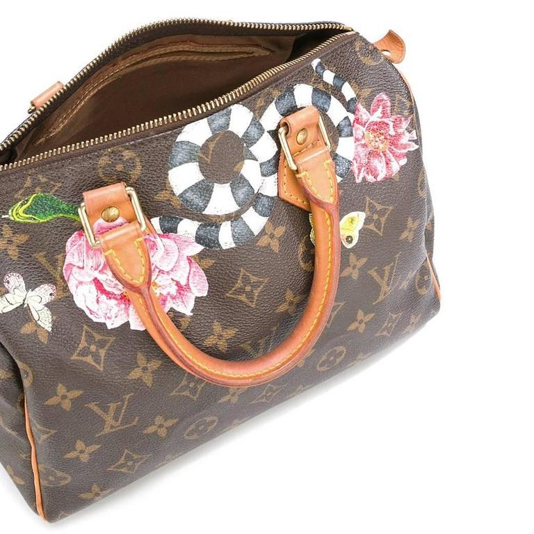 Brown leather 'Speedy' tote from Louis Vuitton Vintage featuring a monogram pattern, a top zip fastening, round top handles, an internal slip pocket and a hand painted design. Please note that vintage items are not new and therefore might have minor
