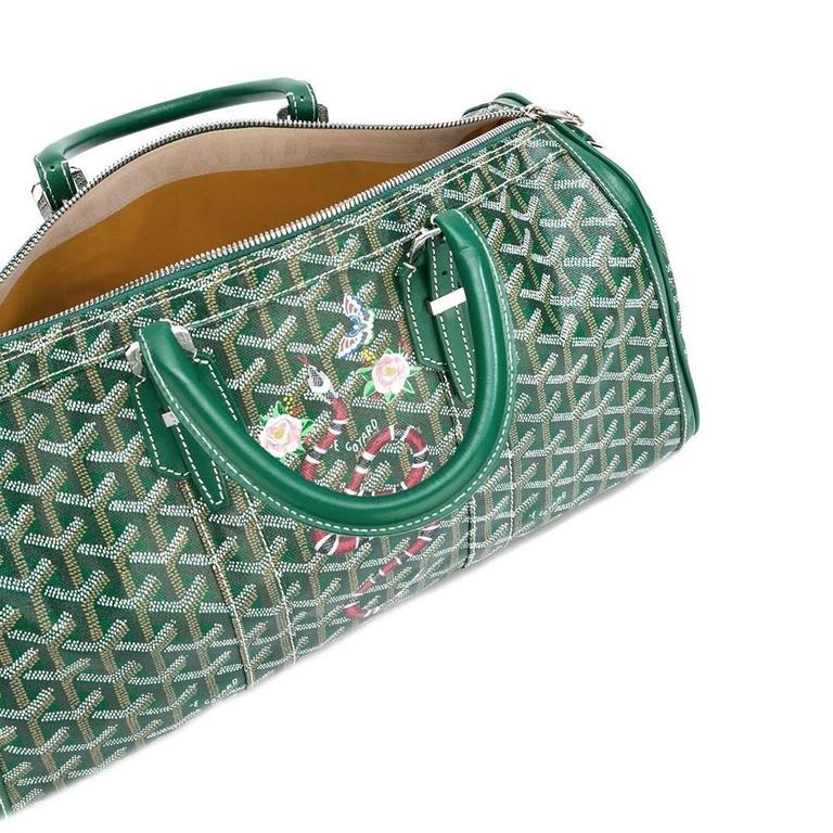 Green leather 'Croisiere' tote from Goyard Vintage featuring a top zip fastening, purse feet, a hand painted chevron and snake design and buckled top handles. Please note that vintage items are not new and therefore might have minor