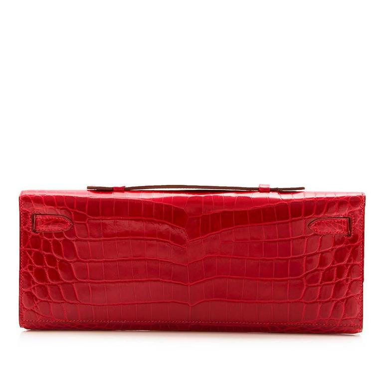 Hermes Braise Red Kelly Cut in shiny Porosus Crocodile withsilver​ hardware. 2