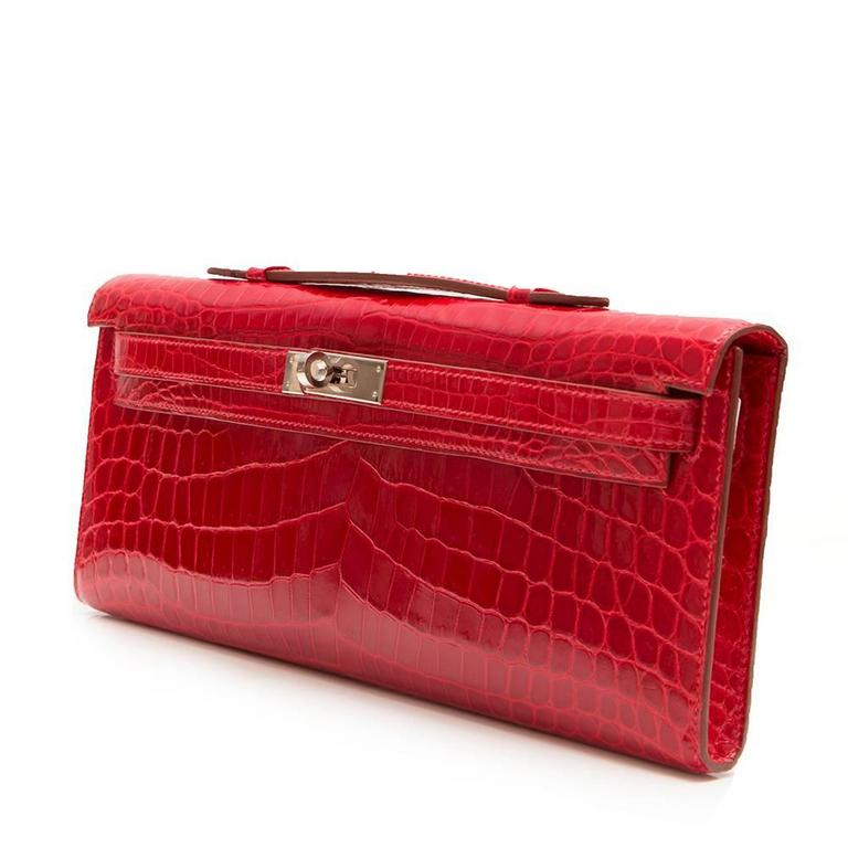 Hermes Braise Red Kelly Cut in shiny Porosus Crocodile withsilver​ hardware. 3