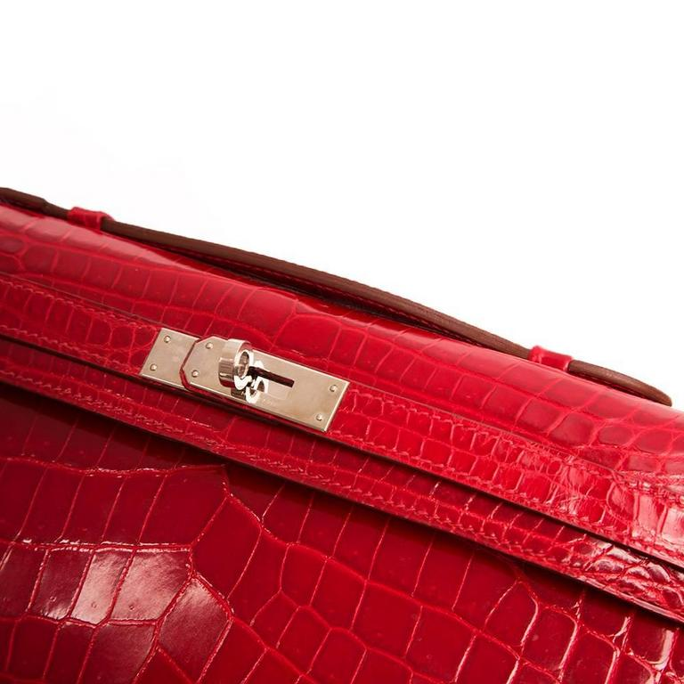 Hermes Braise Red Kelly Cut in shiny Porosus Crocodile withsilver​ hardware. 5
