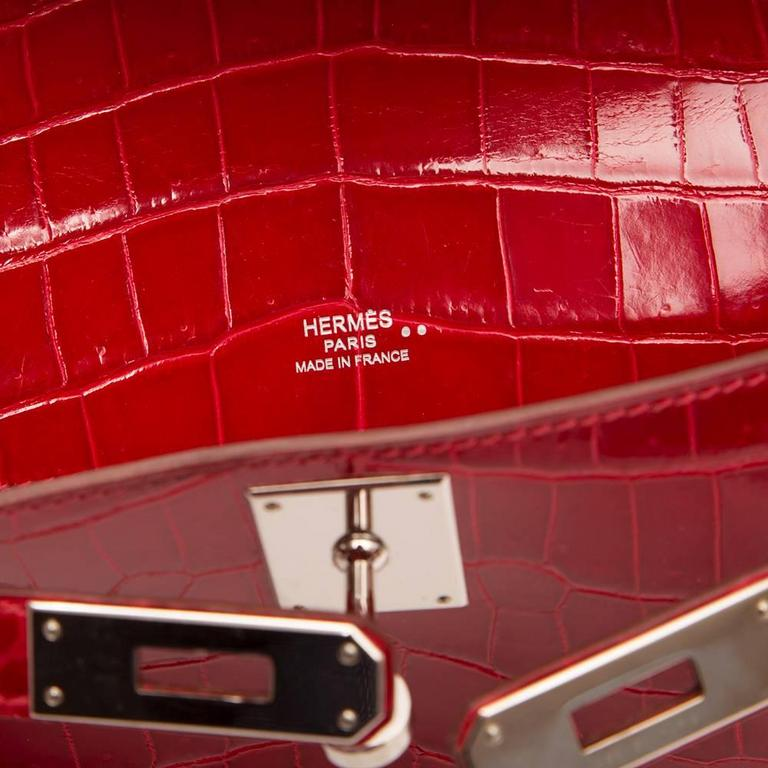 Hermes Braise Red Kelly Cut in shiny Porosus Crocodile withsilver​ hardware. 6