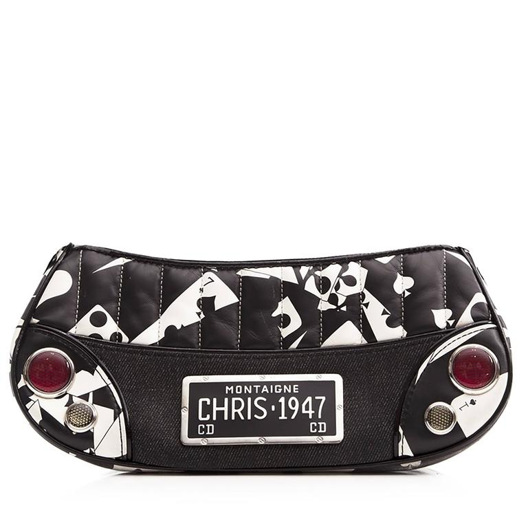 This playing-card patterned bag from Christian Dior is an ace accessory. Its denim and quilted leather exterior is finished with a black patent strap, and a metal Christian Dior plaque placed front and centre. Its interior holds one zipped