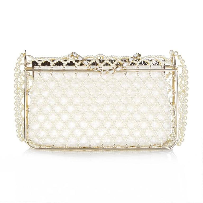 An enchanting edition of the Chanel Classic Flap bag, crafted from a cage of fantasy pearls. Inside the cage is a second clutch, cut from a lustrous, fringed and quilted textile. It is lined with ivory satin, and offset with pale gold-tone hardware.