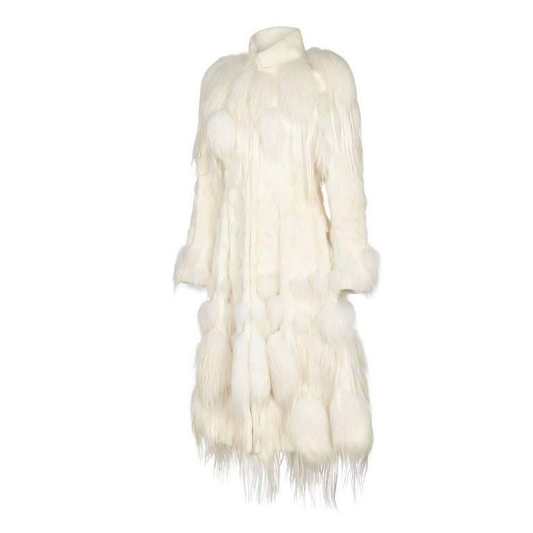 """This showstopping white coat first made its debut at Paris fashion week for Alexander McQueen's """"The Ice Queen and her court"""" 2011 Fall collection. When asked about the inspiration behind this show Creative Director Sarah Burton said """"I"""