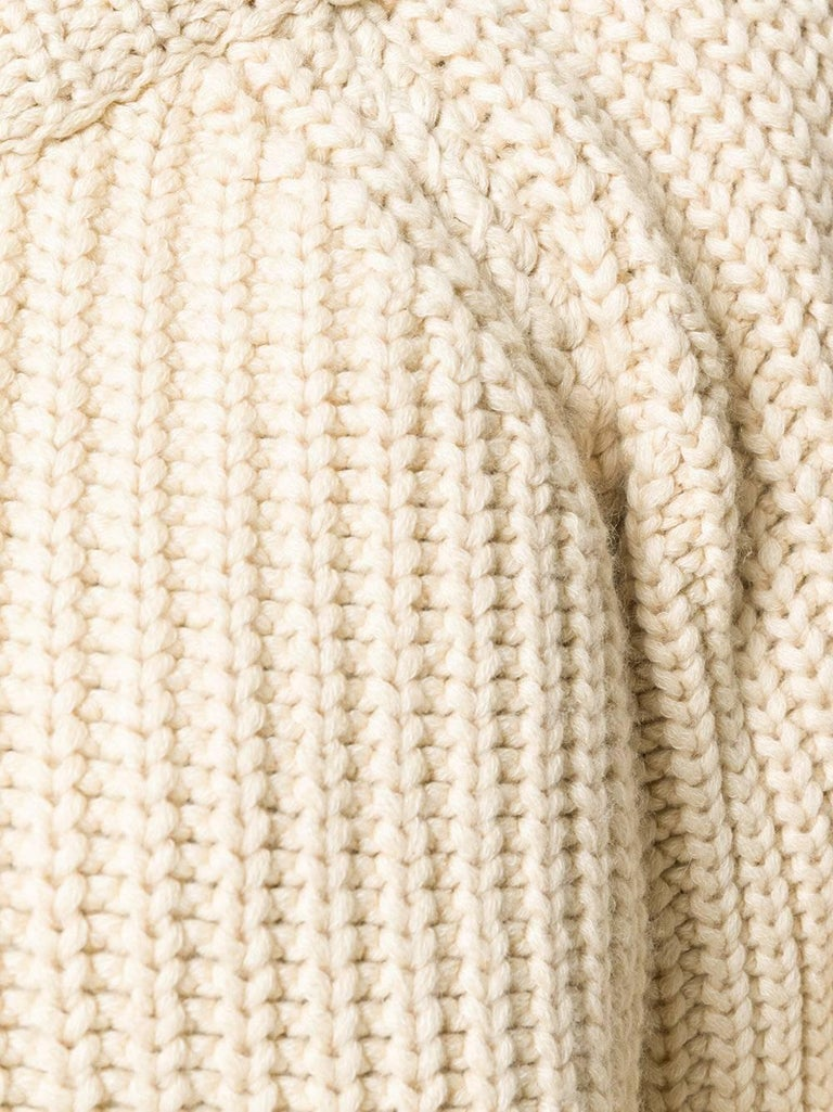 Crafted from a cream beige cashmere-cotton blend, this Hermes chunky jumper features a ribbed crew neck, long sleeves and ribbed cuffs. Perfect for long winter days.  Colour: Cream  Composition: 64% Cashmere, 34% Cotton  Size: 42 FR / 46 IT / 14 UK