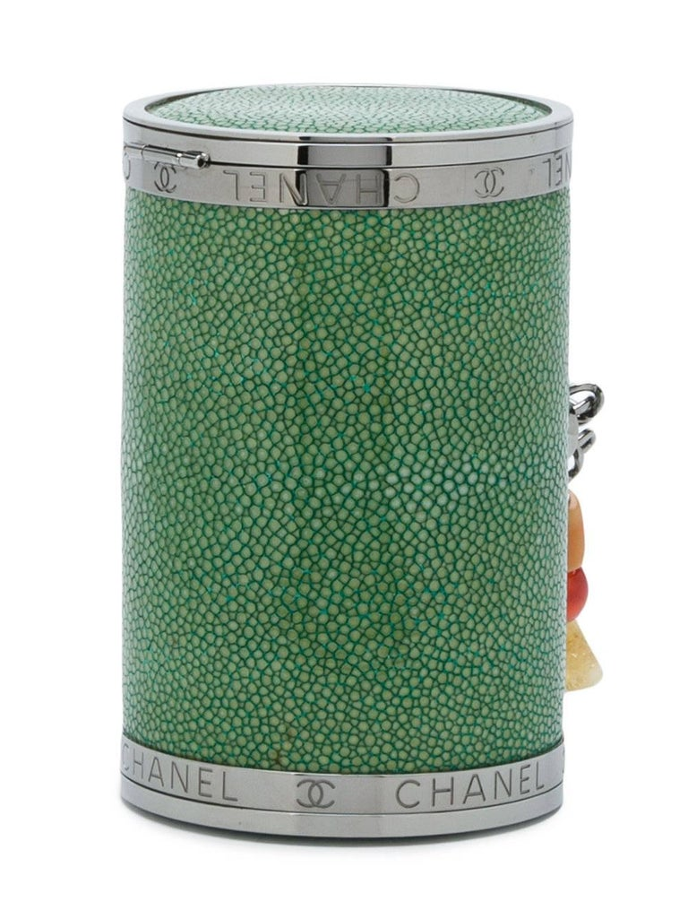 Expertly crafted in France this unique Chanel green stingray barrel clutch features a top clasp fastening, an internal mirror, an embossed logo, an eye-catching colourful beaded hand strap and embossed iconic interlocking CCs.  Colour: