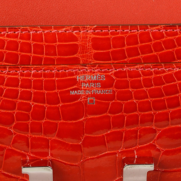 Women's or Men's Hermès Geranium Red Alligator Constance 20cm Wallet For Sale