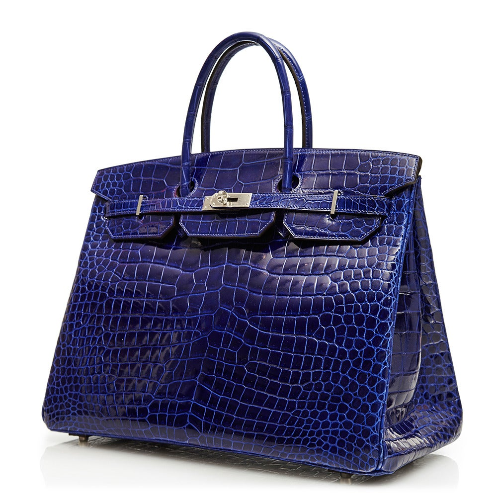 A rarity amongst its counterparts, this Birkin from Hermès is an incredible one-of-a-kind piece. Expertly crafted in crocodile leather, the 40 cm bag features a stand-out Electric Blue colour that is complimented by its silver-tone hardware.