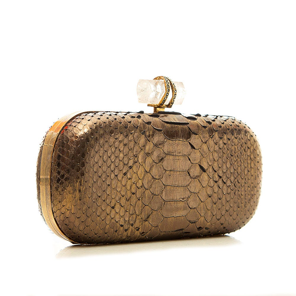 This striking clutch from Marchesa features metallic snakeskin body, gold-tone hardware trims and the brand's signature natural crystal clasp. The contrast lining is crafted in a luxurious fabric and it comes with a gold-tone shoulder