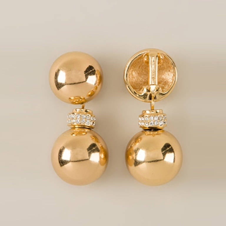 Christian Dior Vintage Drop Ball Earrings.   These gorgeous, impeccably constructed Gold plated metal drop ball earrings from Christian Dior Vintage are accented with crystal embellishments and feature a clip-on fastening.  Colour: