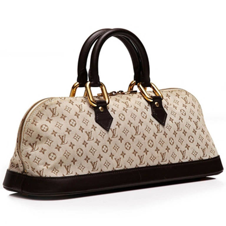 Louis Vuitton Monogram Canvas Bag. Small Louis Vuitton monogram bag with brown leather border around the bottom of the bag, featuring gold tone hardware and zip opening. Internally there is one zip pocket and the bag features a beige material