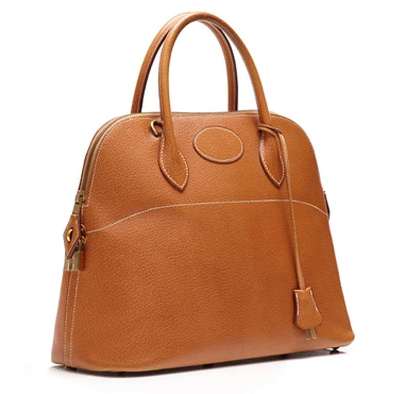 Hermès Vintage Bolide Tan Leather Bag. Bolide handbag from Hermès, a sought after model which was first created by Hermes in 1922 and was the first bag ever to incorporate a zipper. Crafted in tan Epsom Leather and lined with a super- supple leather