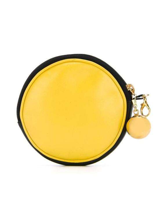 This vintage pouch from Moschino features a smiley face design on the face, a leather body, cotton interior, gold-tone hardware and an orb-detailed zip.