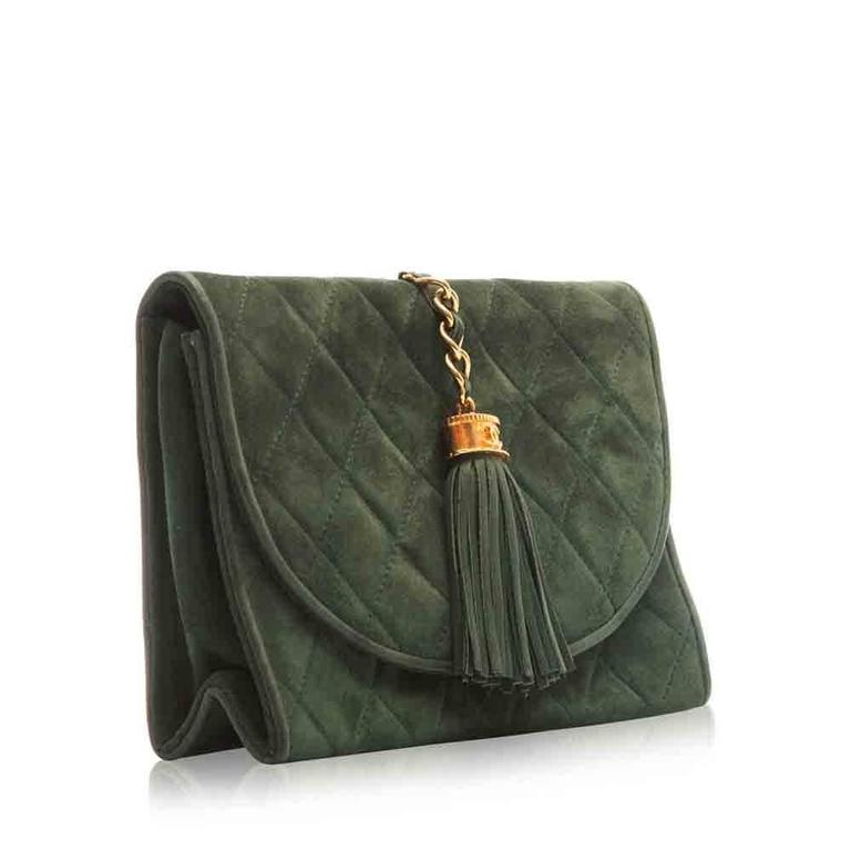 A beautiful green quilted Chanel clutch. The stunning design features gold-plated hardware, internal zip-pocket and a fringe tassel with a CC logo.  Colour: Green  Material: Suede  W: 19cm H: 14cm D: 5cm   Condition: 7/10