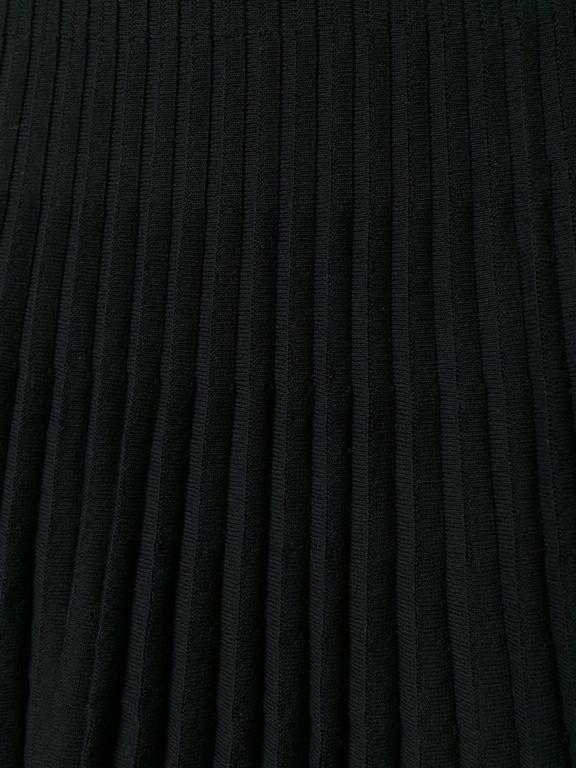 Christian Dior black stretch cotton blend ribbed A-line skirt.  Colour: Black  Size: FR 38  Materials: Spandex/Elastane 10% / Polyamide 13% / Viscose 90% / Cotton 87%  Measurements: hips: 90 centimetres, length: 60 centimetres, waist: 64