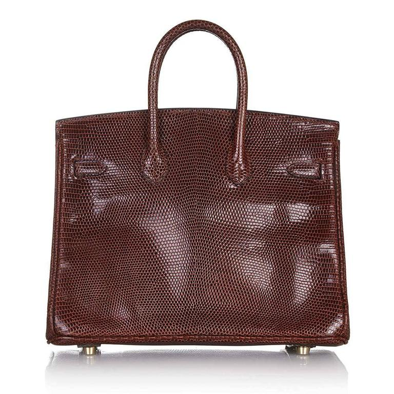 A spectacular edition of the Hermès Birkin handbag. Crafted in lizard skin, which is not usually found on larger leather goods given the rarity and small size of the reptiles. Its textured, Cocaon-coloured exterior is classically offset with