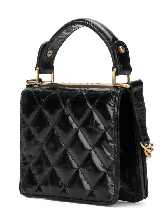 27aea3c991a340 Cute and classic, this Chanel Vintage mini shoulder bag in quilted black  lambskin features a
