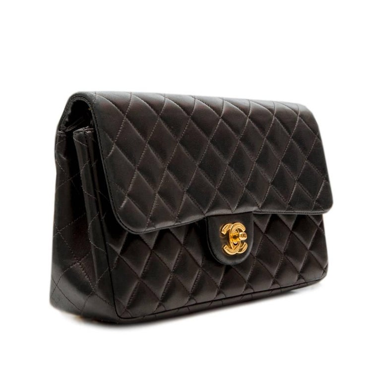 This backpack is a fun and practical adaptation of the classic, well-loved Chanel 2.55 bag. Ideal for travelling, this effortless bag is expertly crafted from quilted black lambskin and features gold-tone hardware. This is complemented by a foldover