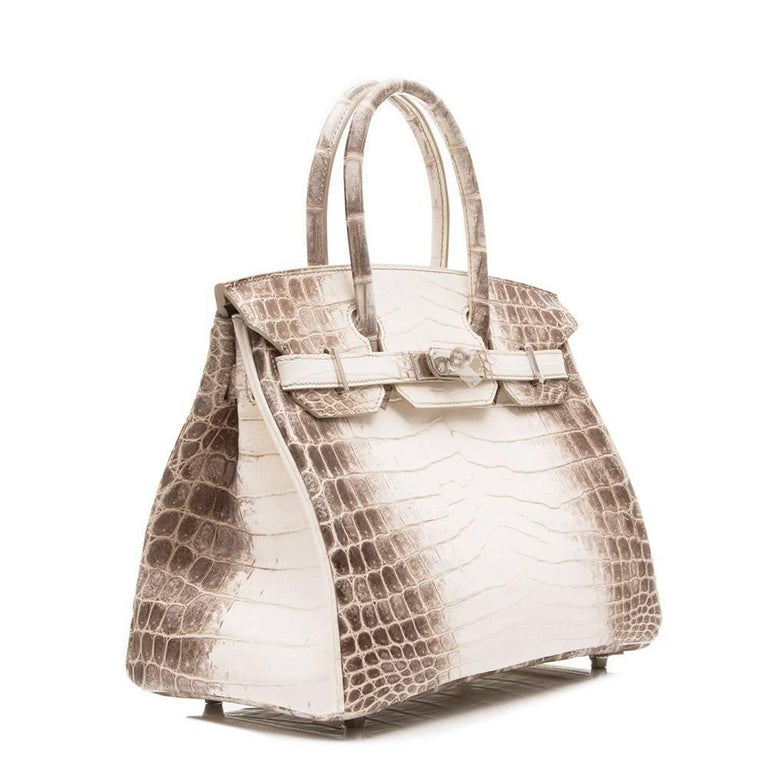 The most sought after of all the Hermes bags, this beautifully crafted, rare Birkin is made from matte Niloticus crocodile leather and features palladium hardware.  Lined with grey goat skin leather the bag's interior boasts one zipped and one open