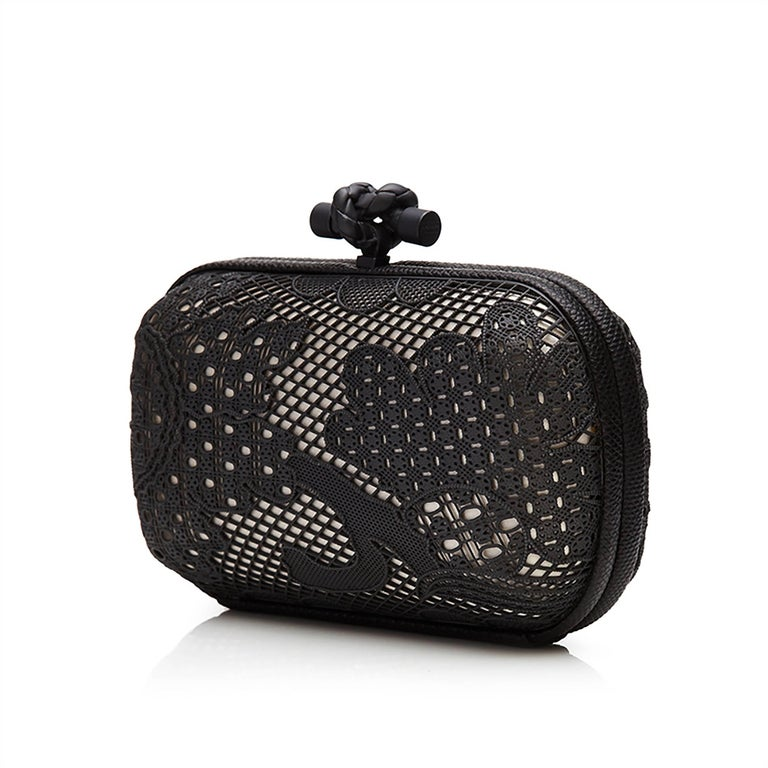 This feminine reimagining of Bottega Veneta's famed Knot clutch bag is adorned with an ornate metal overlay resembling lace. Beautifully intricate in its construction, its monochrome exterior is finished with Bottega Veneta's ubiquitous knot-shaped