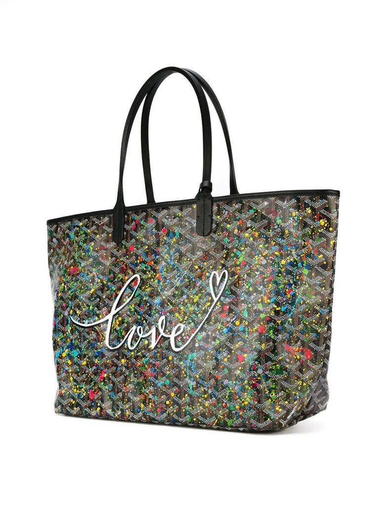 Crafted from Goyardine Canvas, a coloured textile made from cotton, linen and hemp, this black and brown Monogram St Louis tote Bag is adorned with a hand-painted 'splattered paint' design and the word 'Love' in the style of Jackson Pollock, as a