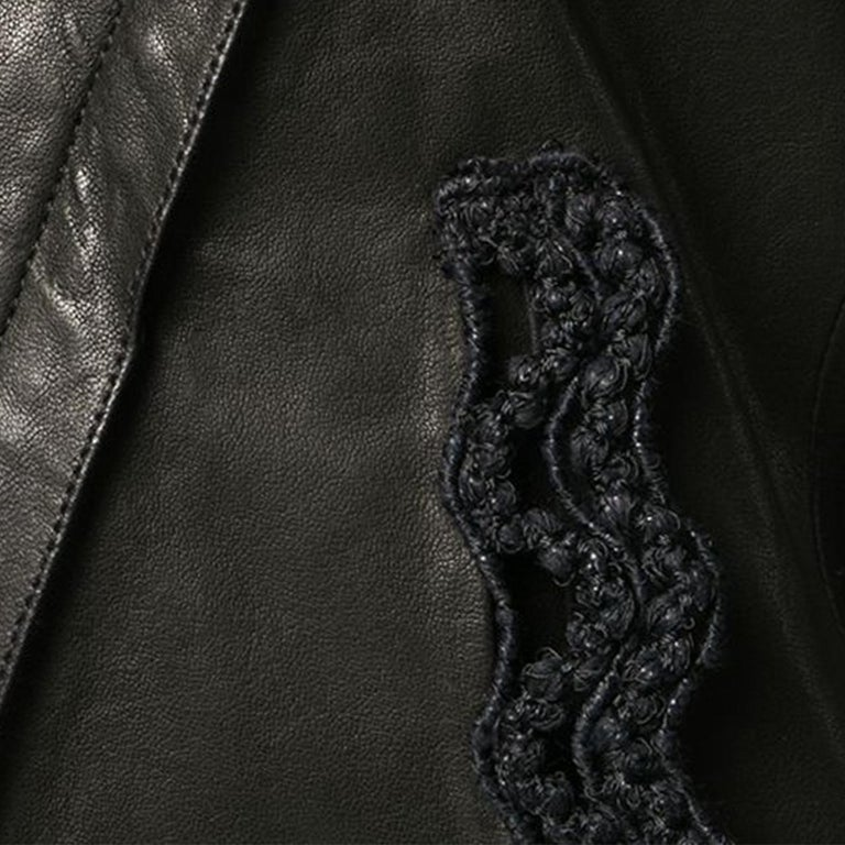 Expertly cut and crafted from smooth black lambskin and a delightful silk lining, this long sleeved biker jacket features a cropped length and the distinct, modern design of crochet trim detailing around the wide lapel. The off-centre front zip