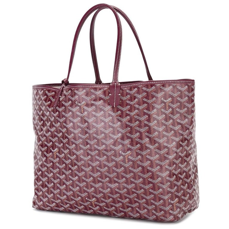 A handbag to truly set your heart aflutter, this burgundy Monogram St Louis tote Bag was crafted from Goyardine Canvas, a coloured textile made from cotton, linen and hemp, and vitalised by a flurry of custom hand-painted butterflies (not original
