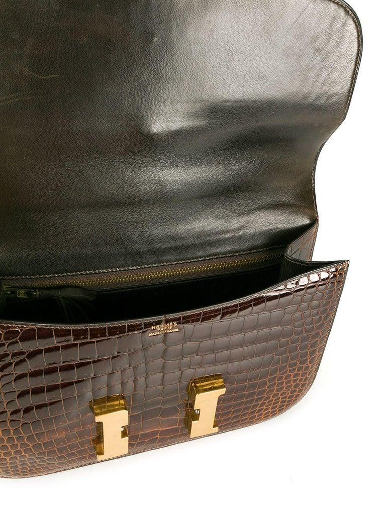 Brown Hermès Miel 23cm Crocodile Constance Bag For Sale