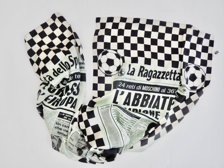 A modernist, vintage silk scarf from the 1990s by the innovative designer Franco Moschino (1950-94).  The irreverent, whimsical design satirizes a sports newspaper and exemplifies Moschino's reputation as an unconventional, avant-garde designer.  A
