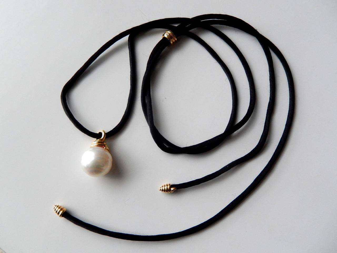 and co south sea pearl gold necklace on silk cord
