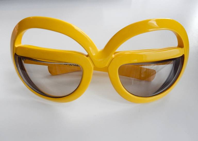 A pair of seventies glasses with an innovative space-age design by the visionary Austrian eyewear company Silhouette (no pun intended.)  Founded in 1964 in Linz, Silhouette is one of the leading eyewear companies in the world. Since their beginning,
