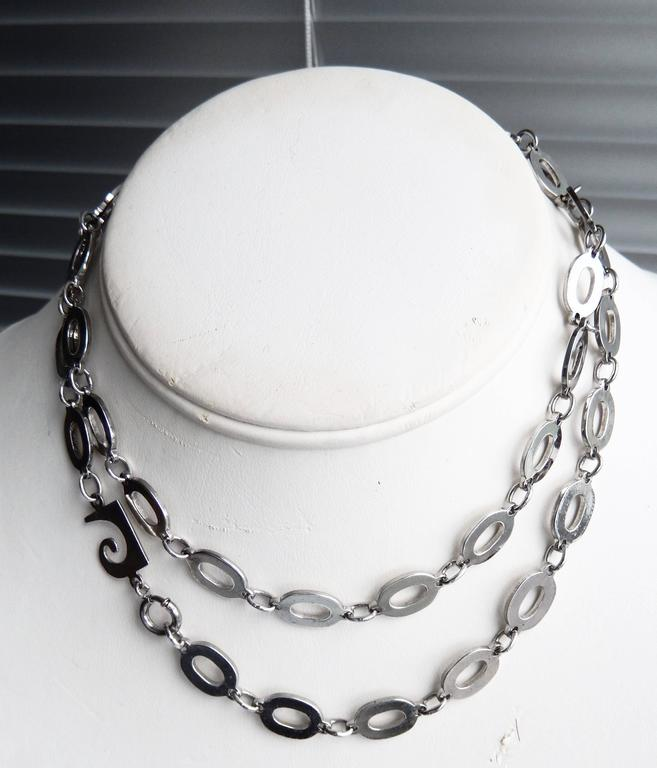 A sterling silver chain necklace with geometric, oval links by the futuristic designer Pierre Cardin.  A scarce necklace with a very cool, minimalist 70s design. Marked.