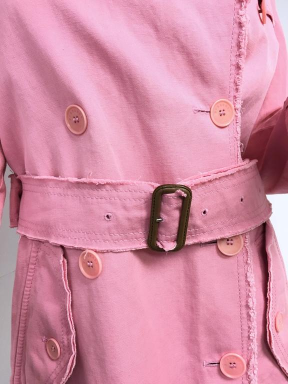 Burberry London pink double breasted trench coat.  Size Small (4)  Nova check lining, notched collar, apalettes, dual flap pockets at hip,  long sleeves with belted cuffs, removable belt at waist. Closure/Opening: Double breasted button front