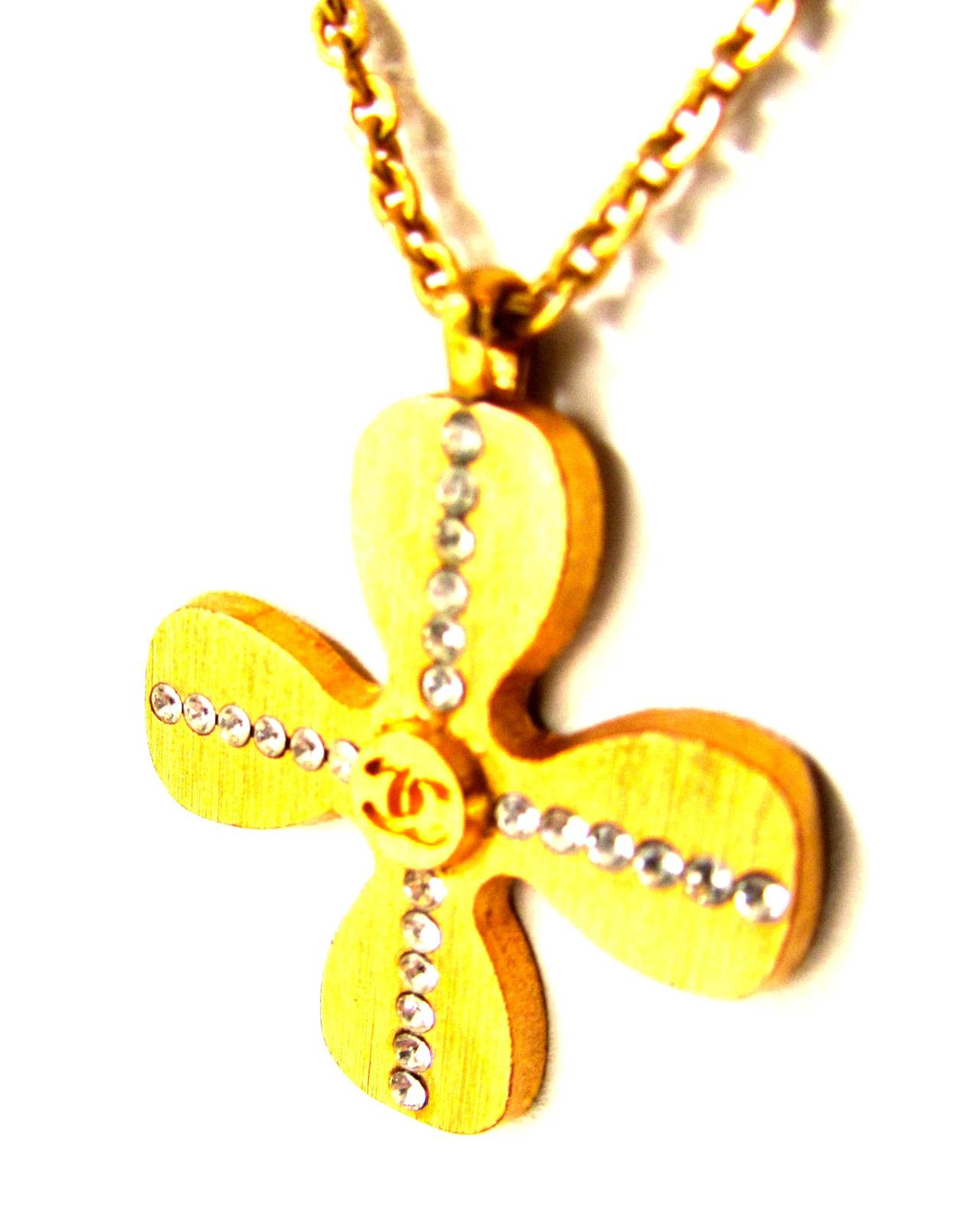 Contemporary Chanel Gold Tone Necklace - Clover Shaped Charm with Crystal Cross Inlay For Sale