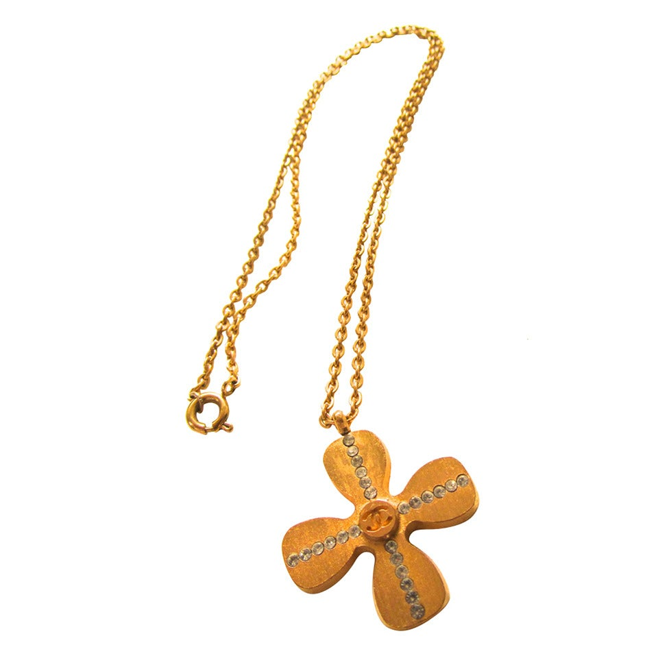 Chanel Gold Tone Necklace - Clover Shaped Charm with Crystal Cross Inlay For Sale
