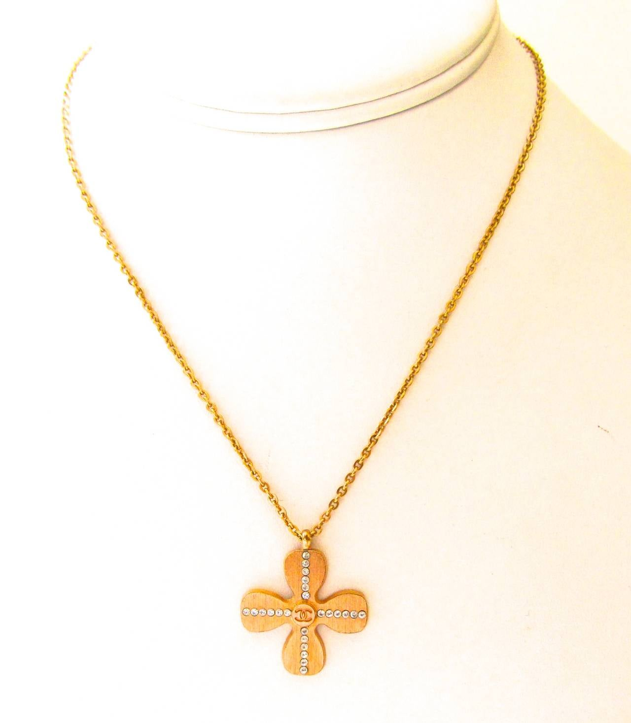 Chanel Gold Tone Necklace - Clover Shaped Charm with Crystal Cross Inlay In Excellent Condition For Sale In Boca Raton, FL