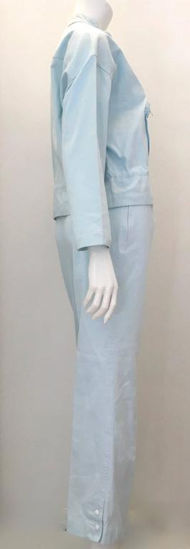Presented here is a 2 piece light blue Courreges Pant suit. This is a casual day time Courreges ensemble from the 1980's. It is meant to be worn together, but the jacket is fabulous on its own. The jacket is marked size 'Medium' and has a string tie