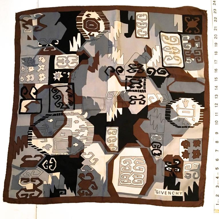 Presented here is a beautiful scarf from Givenchy. The scarf is made from 100% silk and is from the 1970's. The scarf is hand rolled and is comprised of colors of shades of gray, brown, cream, tan, white, silver and black. The design is a