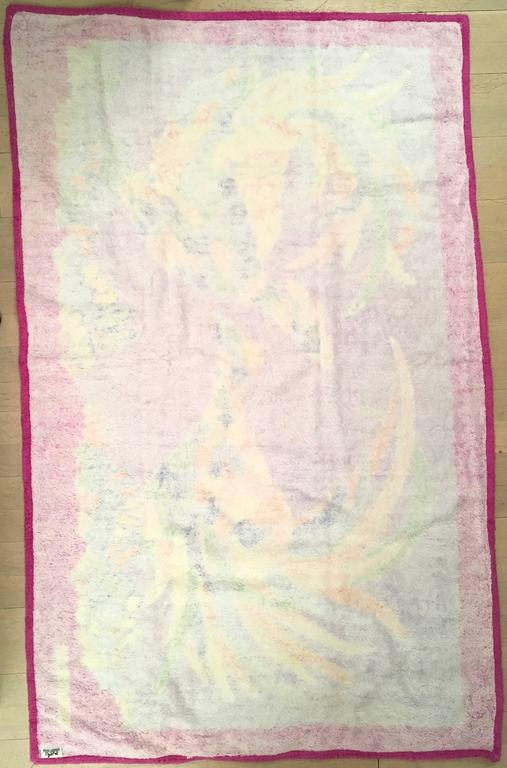 Presented here is a rare Hermes beach towel. The design is comprised of two beautifully colored birds with varying shades of blue, green, yellow and orange. The two birds have long flowing tail feathers. The 3 inch magenta border the beautiful
